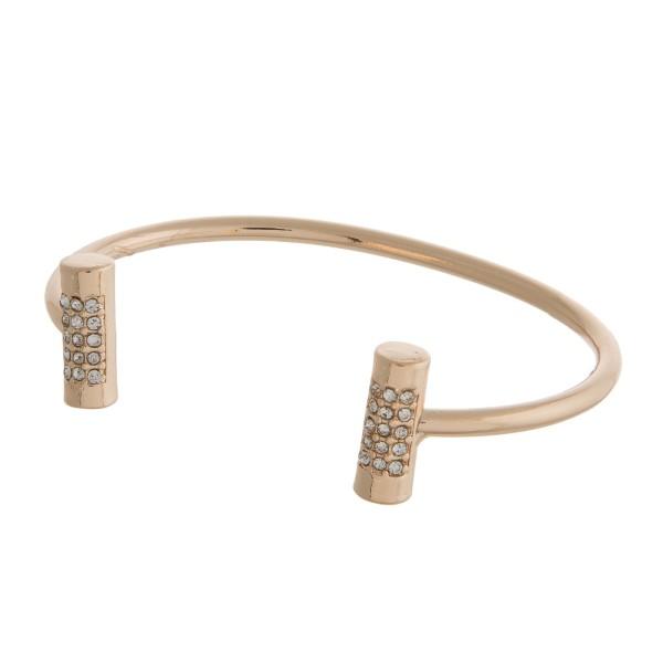Dainty metal cuff bracelet with clear rhinestone accents.
