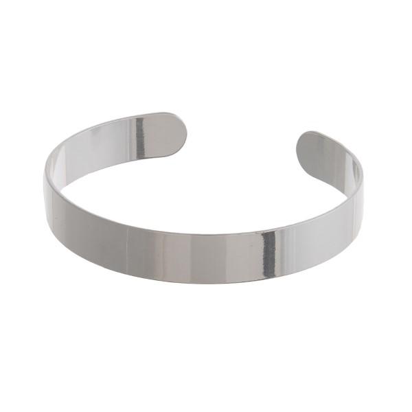Silver tone cuff bracelet with a shiny finish.