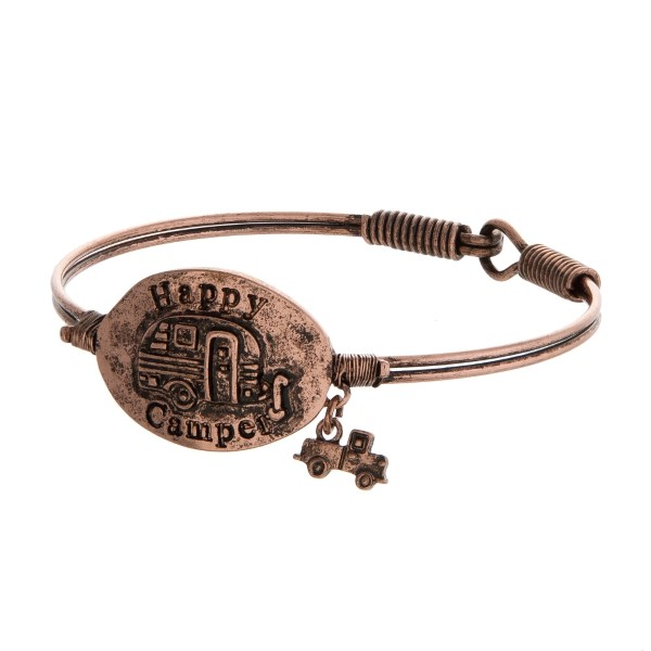 """Burnished, bangle bracelet with a focal stamped with """"Happy Camper."""""""