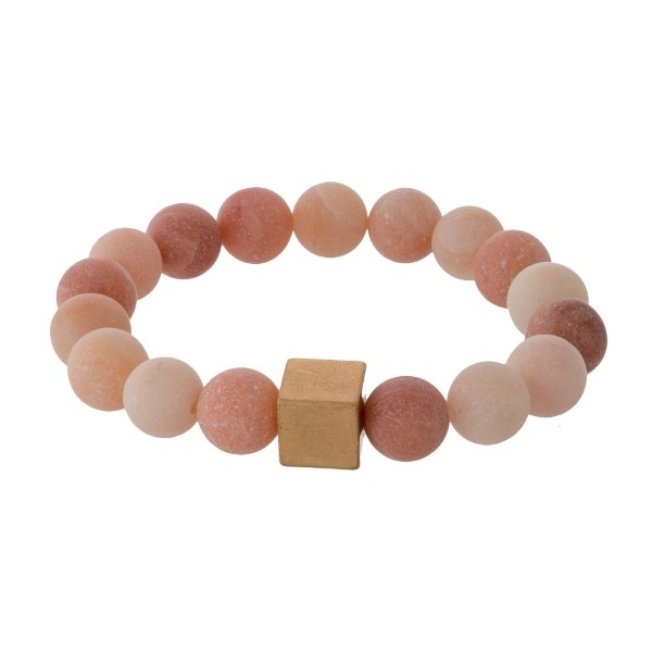 Natural stone beaded stretch bracelet with a gold tone square bead accent.