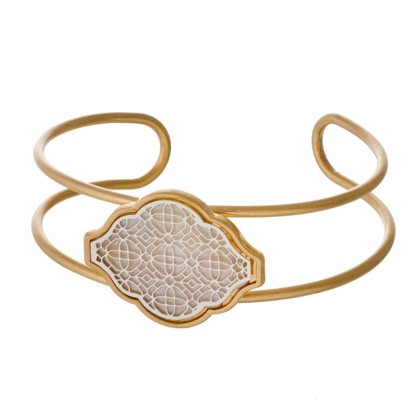 Two tone metal bracelet with filigree design.