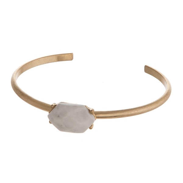 Gold tone cuff bracelet with natural stone focal.