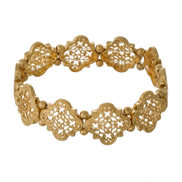 Metal stretch bracelet with quatrefoil design.