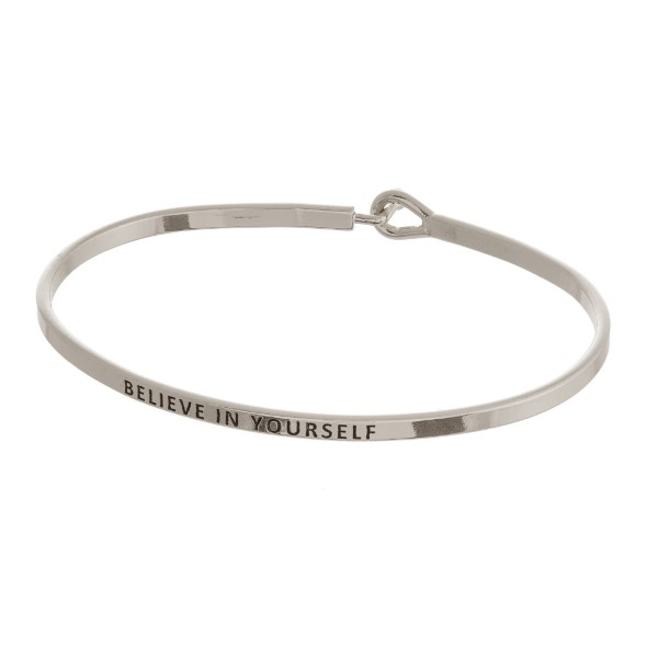 Metal bracelet stamped with an encouraging message.