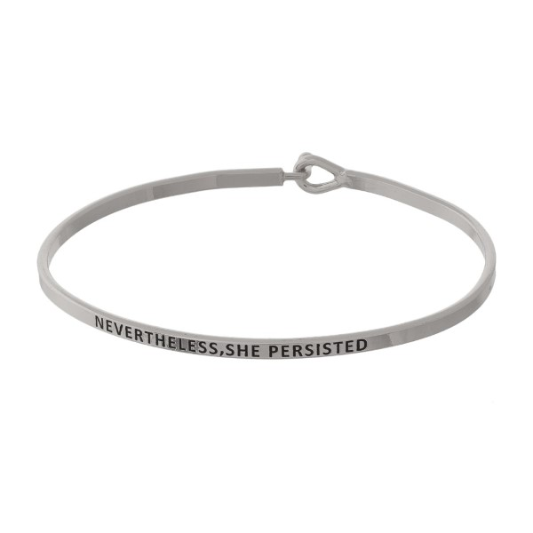 "Metal bracelet with engraved message, ""Nevertheless, She Persisted."""