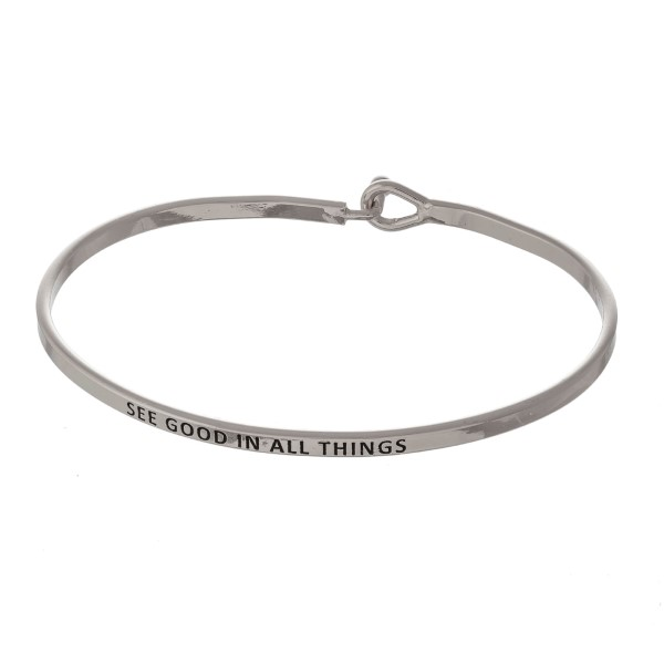 "Metal bracelet with engraved message, ""See Good In All Things."""