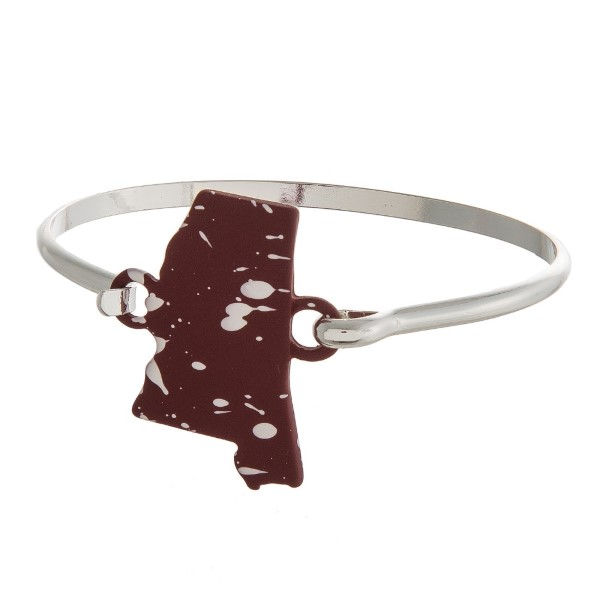 Metal bracelet with state focal and latch closure.
