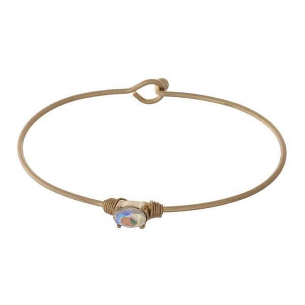 Dainty gold tone bracelet with crystal focal.