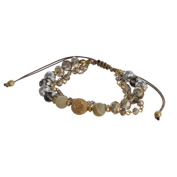 Layered, adjustable bracelet with faceted beads and druzy accent.