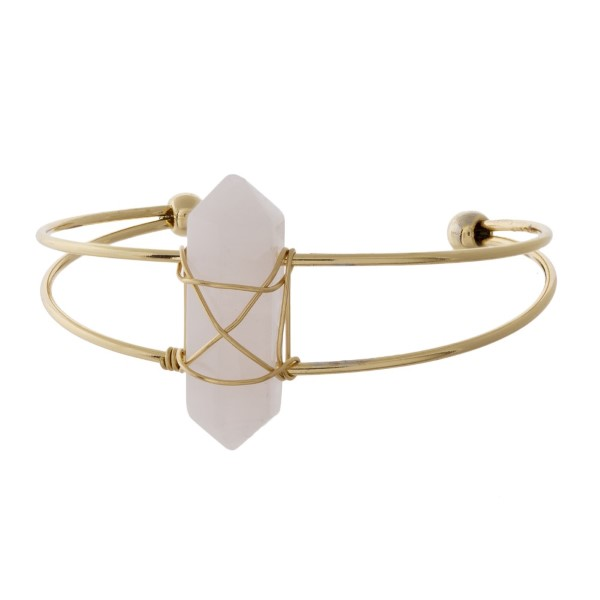 Gold tone cuff bracelet with natural stone crystal.