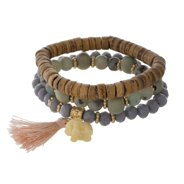 Stretch bracelet set with natural stone and wooden beads and soft tassel.