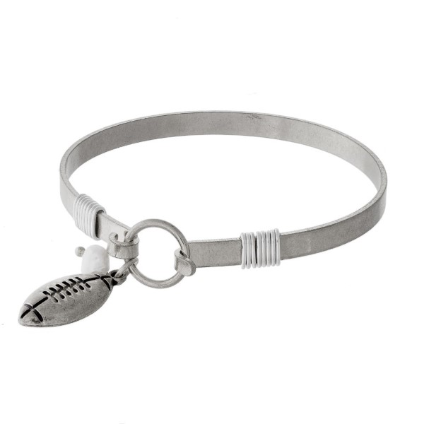 Metal bracelet with football charm.