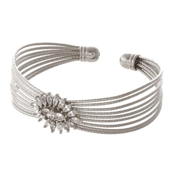 Metal cuff bracelet with rhinestone detail.