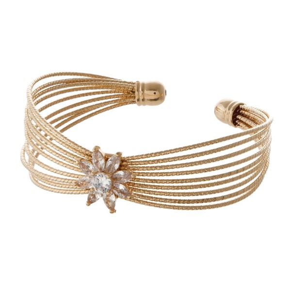 Metal cuff bracelet with rhinestone detail.