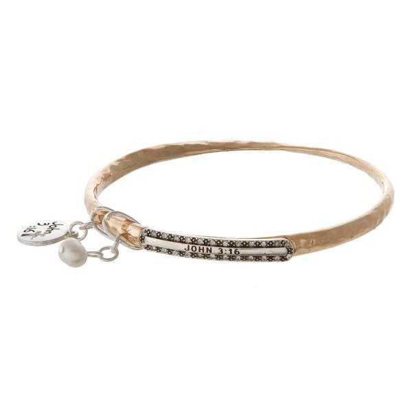 Metal bangle bracelet stamped with John 3:16.