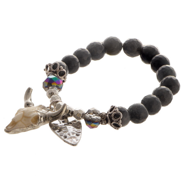 Beaded stretch bracelet with steer head charm.