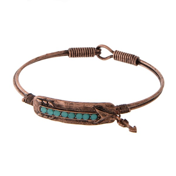 Metal bracelet with latch closure and arrow detail.