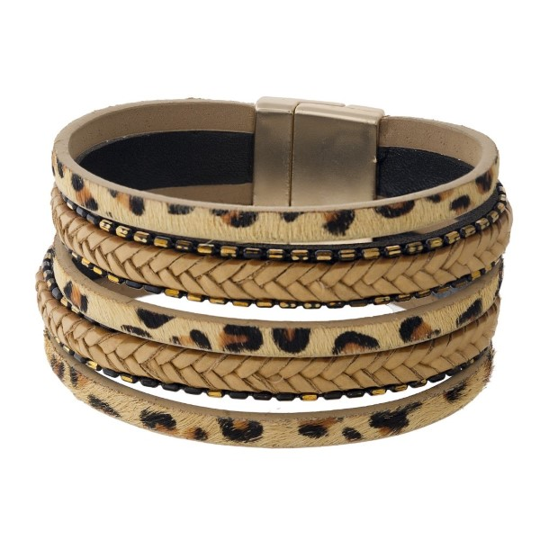 Magnetic bracelet with braid and animal print detail.
