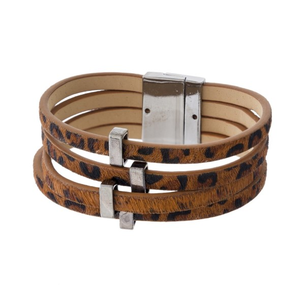 Faux leather animal print bracelet with magnetic closure.