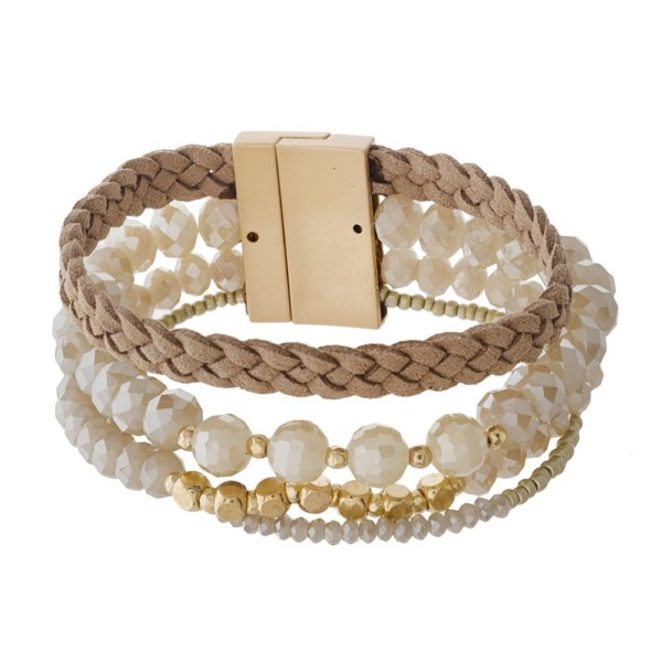 Magnetic bracelet with faceted beads and faux leather braid detail.