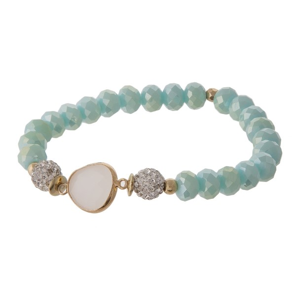 Stretch bracelet with faceted beads and natural stone focal.