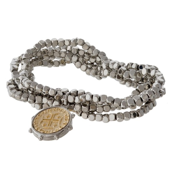 Stretch bracelet set with a coin charm.