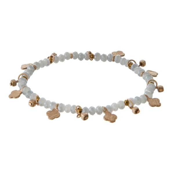 Faceted bead stretch bracelet with clover charms.