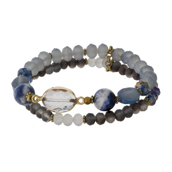 Stretch bracelet set with faceted beads and natural stone detail.