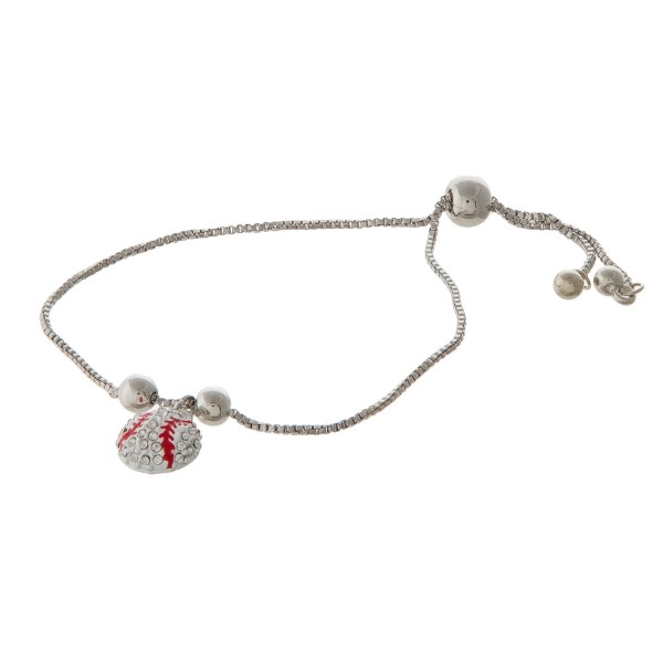 Adjustable metal bracelet with sports ball charm.