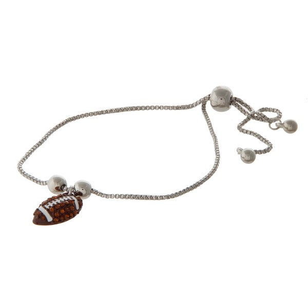 Adjustable metal bracelet with sports ball charm.
