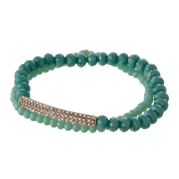 Stretch bracelet with faceted beads and rhinestone detail.