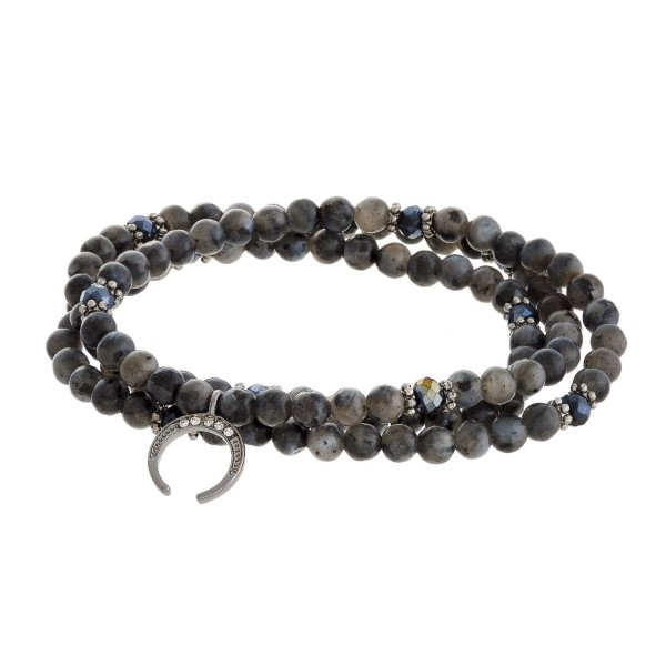 Beaded wrap bracelet with crescent horn charm.