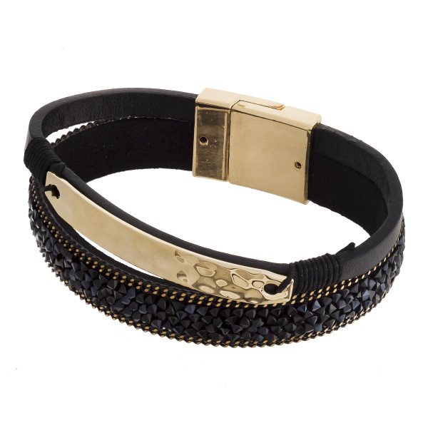 "Faux leather bracelet featuring a gold hammered focal with rhinestone details and a magnetic clasp closure. Approximately 2.5"" in diameter. Fits up to a 5"" wrist."
