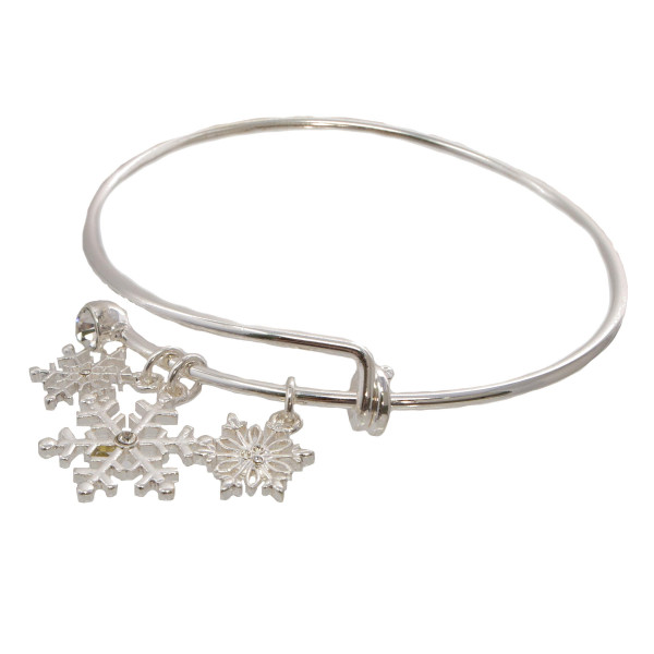 Metal bracelet with snowflake charms.