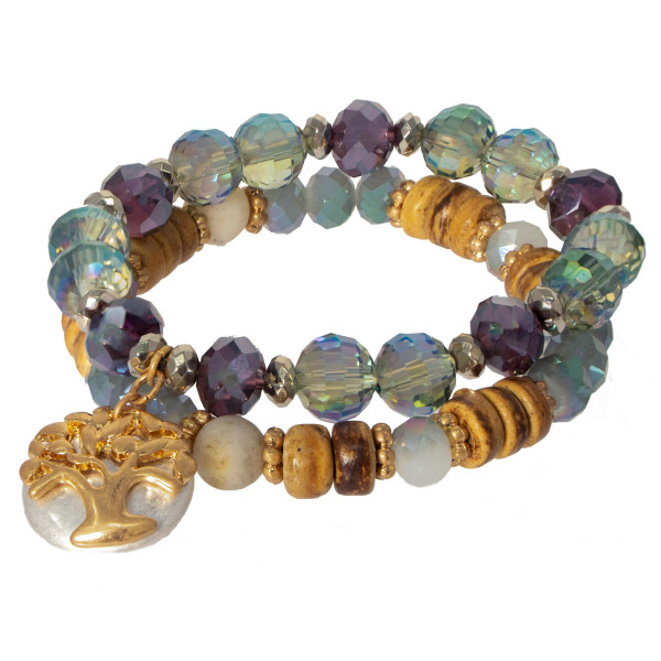 Beaded stretch bracelet set with a circle of life charm.