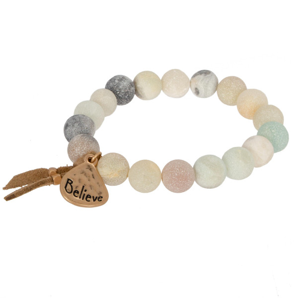 Natural stone stretch bracelet with gold charm stamped with Believe.