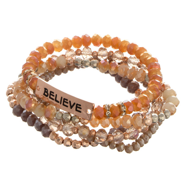"Beaded stone stretch bracelet with a bar focal, stamped with ""Believe."""