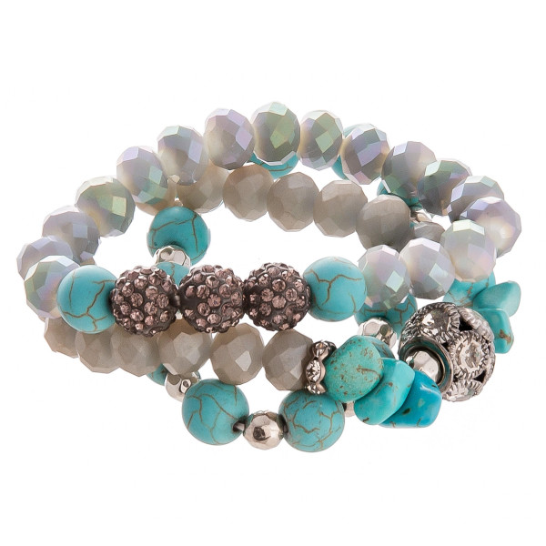 "Beautiful layered natural stone with rhinestone bracelet. Stretches for that prefect fit. Approximate 3"" in diameter."
