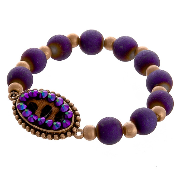 """Very cute beaded stretch bracelet- includes animal printed pendant with rhinestones.  Approximate 3"""" in diameter. 6"""" long."""