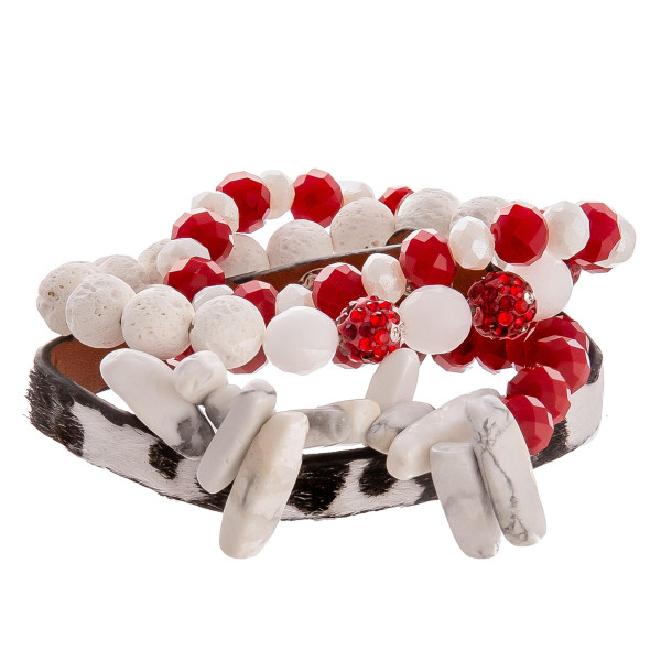"Gorgeous natural stone and bead bracelet with leather animal print snap bracelet. Approximate 3"" in diameter."