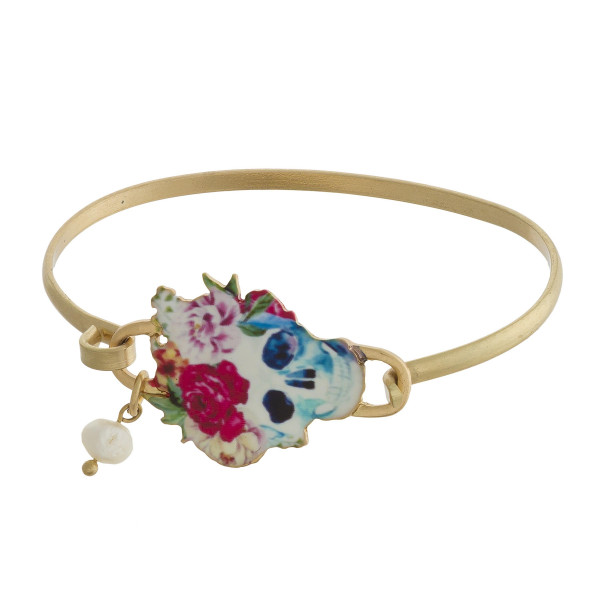 Floral skull bangle bracelet with pearl charm detail.