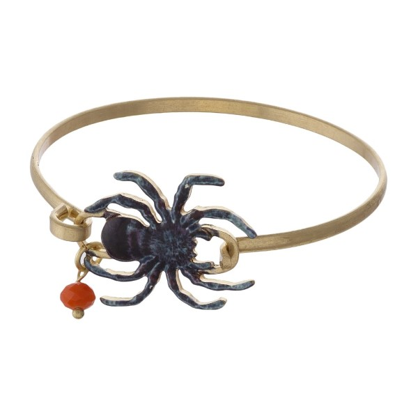 Gold tone metal bracelet with spider focal.