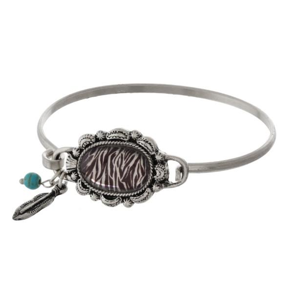 Metal bracelet with animal print focal.