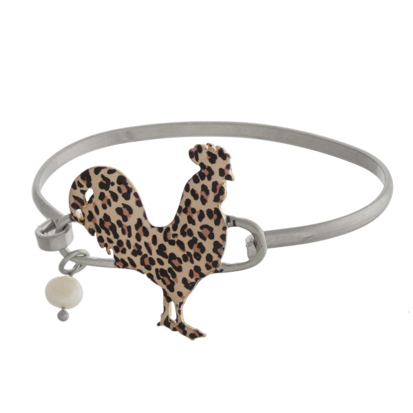Leopard print rooster bangle bracelet with pearl charm detail.