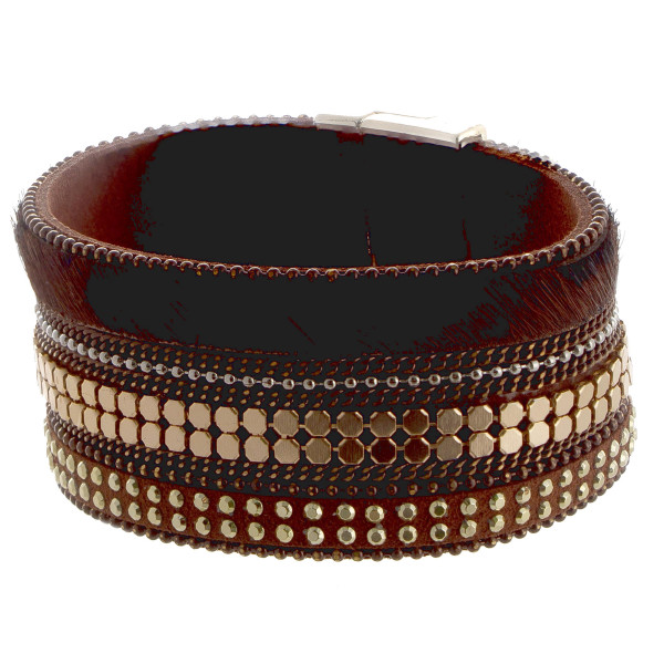 Magnetic leather cuff bracelet with animal print and jeweled detail.