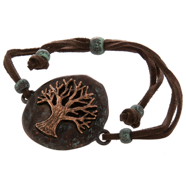"""Leather bracelet with """"Tree of Life"""" charm with adjustable straps . Approximate 8"""" in length with 2"""" pendant."""