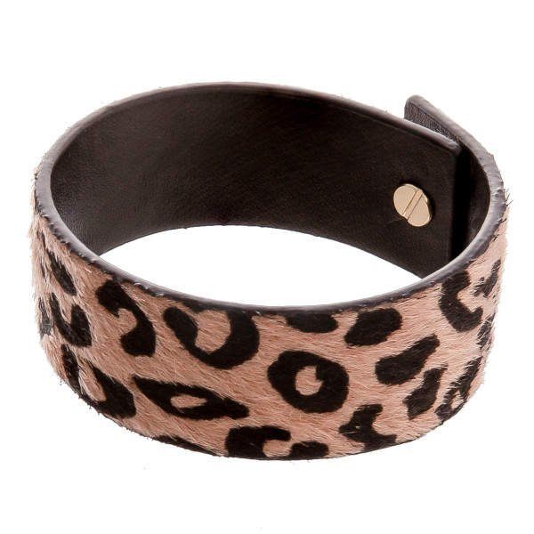 """Animal print bracelet with button snap. Approximate 8"""" in length."""