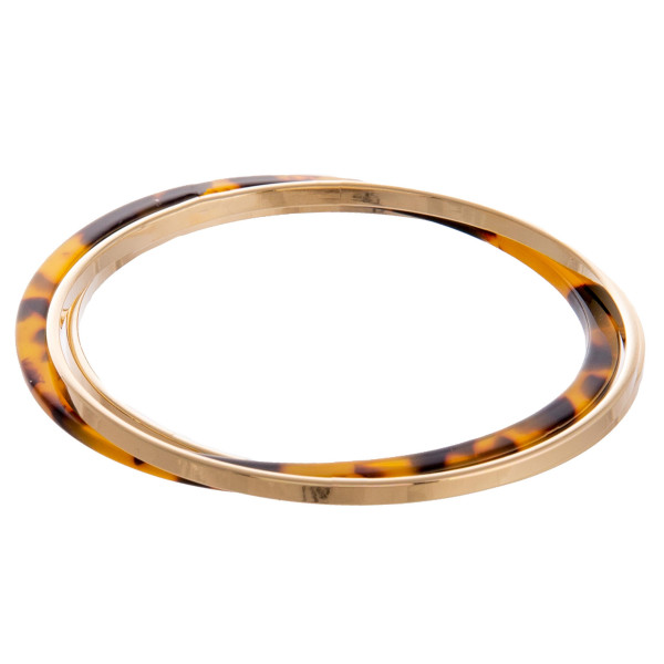 Gold metal bangles with acetate bangle. Approximate 2.5 in diameter.