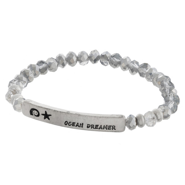 """Beaded stretch bracelet with 'ocean dreamer' engraved. Approximate 6"""" in length."""