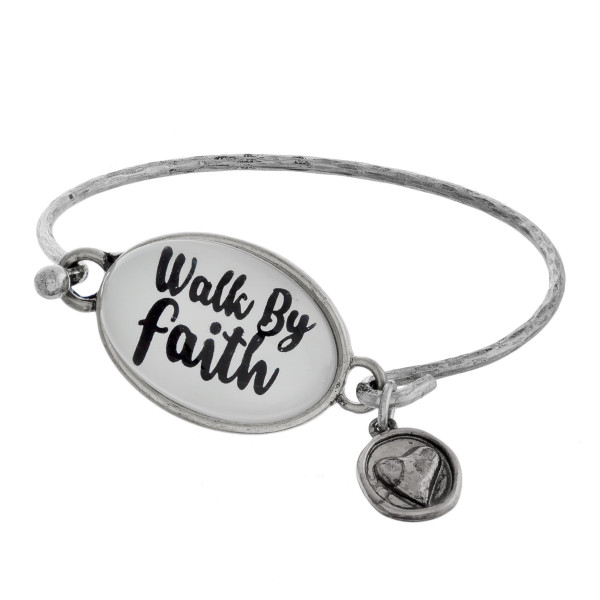 Cuff bracelet with charms and positive message. Approximate 2.5 in diameter.